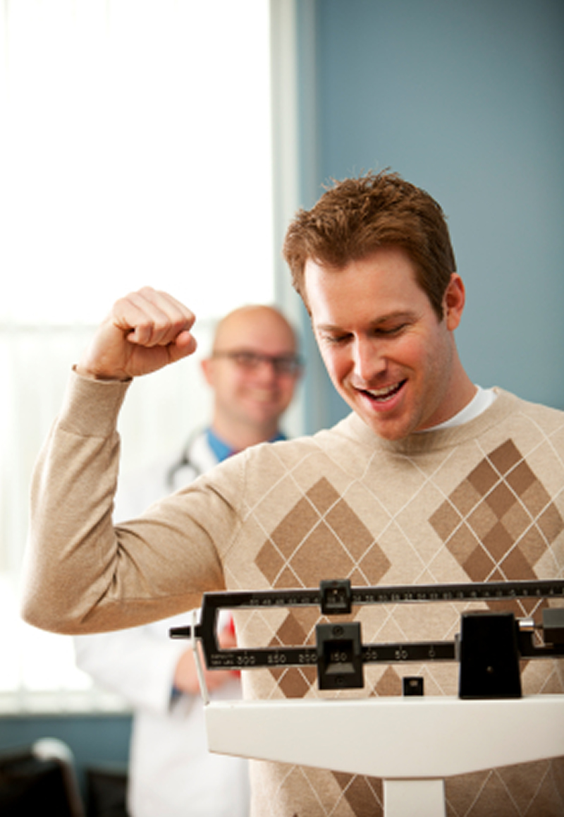 weight loss okotoks - happy guy on scale